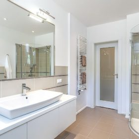 21122774 - bright space - a white and beige bathroom with a sink and a shower